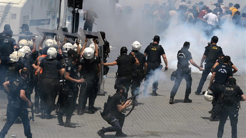 Riot police have pushed protesters back from Taksim Square [AP]