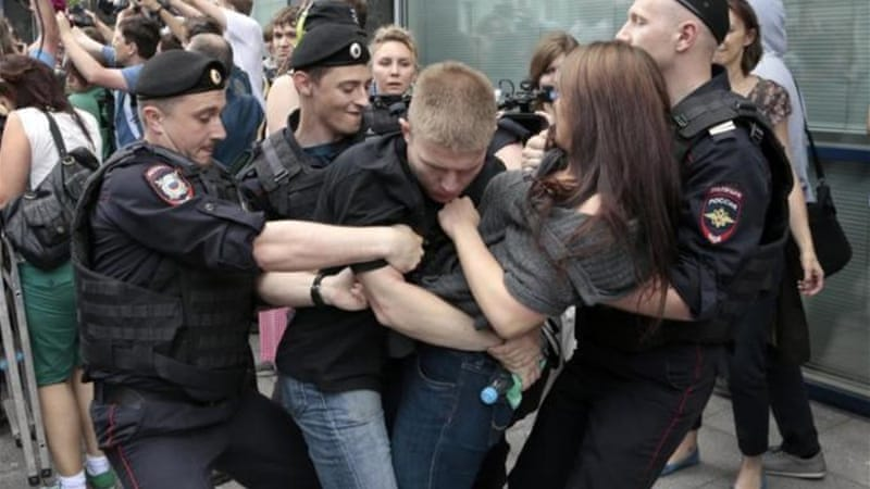 Policemen detained gay rights activists as they gathered near the Duma, Russia's lower parliament chamber [AFP]