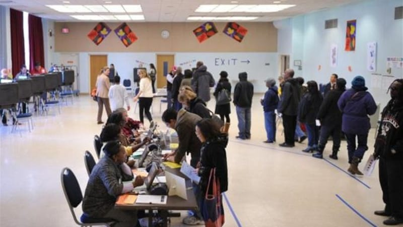 Voters in many low-income communities have been forced to wait for hours to cast their votes while polling places in affluent suburbs remained queue-free during the US presidential elections [AFP]