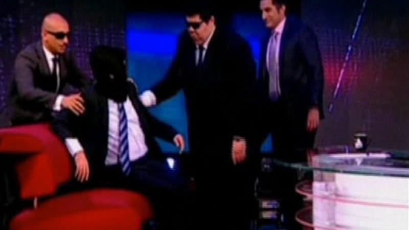 Jon Stewart wore a black hood and was introduced by host Bassem Youssef as a captured foreign spy