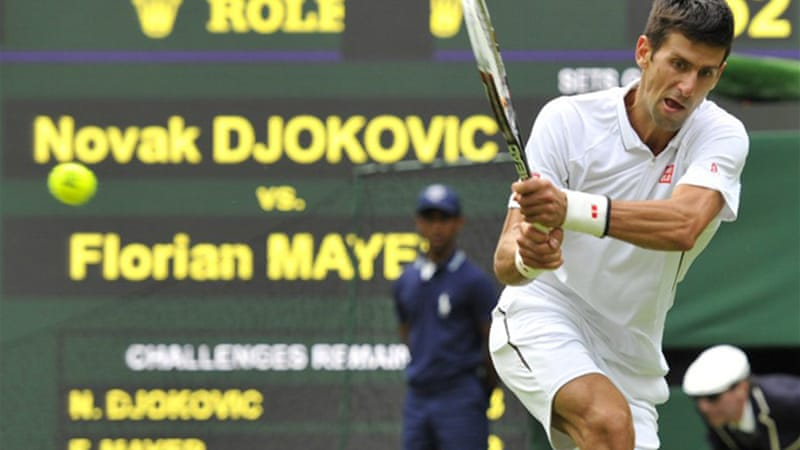 Djokovic beat Germany's Florian Mayer in the Serb's first grass-court outing of the season [AFP]