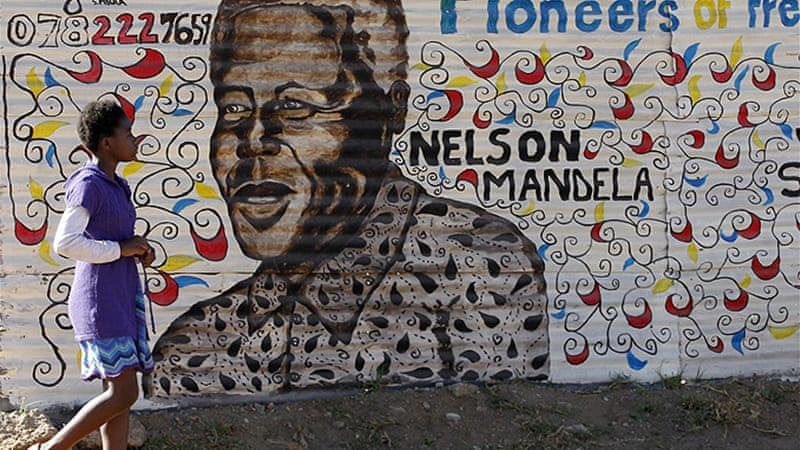 Mandela lies critically ill in what is now his fourth week in hospital [Reuters]