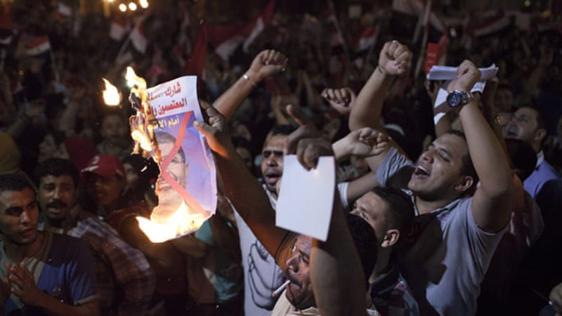 President Mohamed Morsi's legitimacy is at the heart of protests both for and against him [Getty Images]