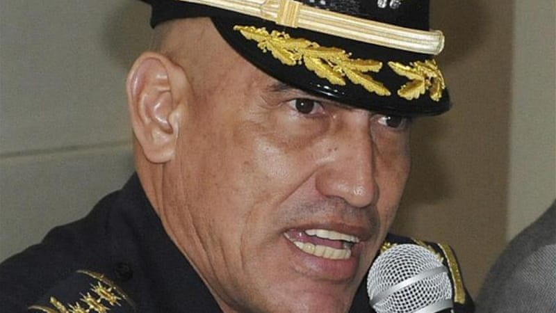 "The director of the Honduran Police, Juan Carlos ""El Tigre"" Bonilla, is allegedly linked to three homicides [AP]"