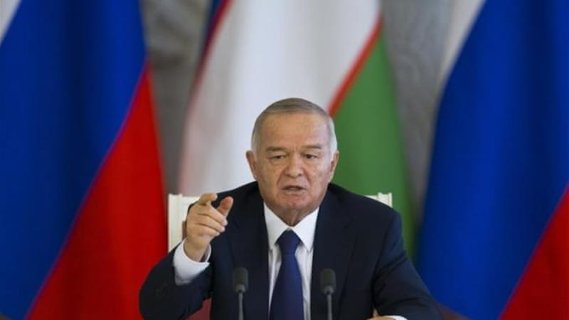 Uzbek President Islam Karimov has referred to Uzbeks working abroad as 'lazy' [AP]