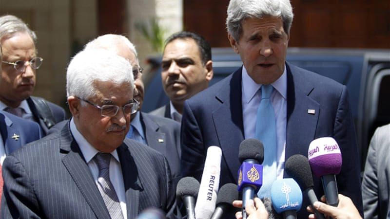 Mahmoud Abbas, the Palestinian president, held talks with John Kerry, the US secretary of state, in Jordan [Reuters]