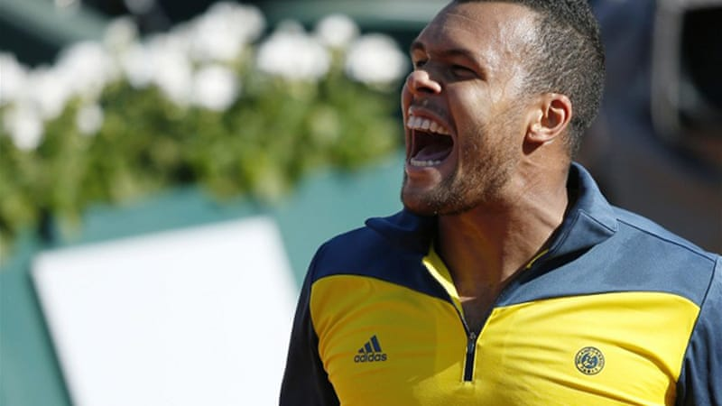 A jubilant Tsonga ended Federer's dreams of winning a record 58th career match at Roland Garros [AFP]