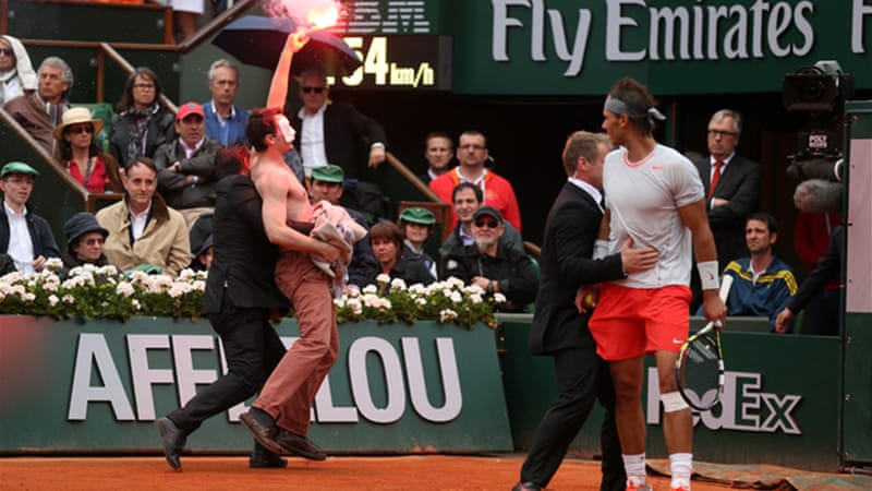 Nadal kept his concentration despite an invasion by a protester carrying a flare [GALLO/GETTY]