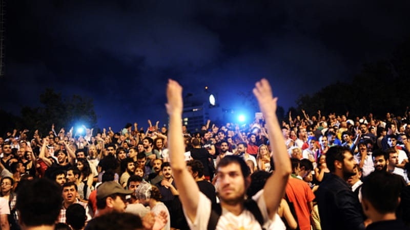 Turkish anti-government protesters demonstrate at the entrance of Gezi park on the first day or Ramadan [AFP]