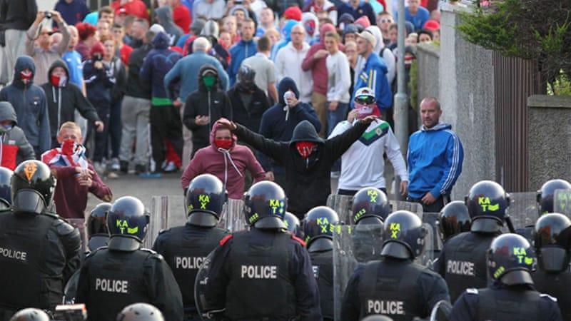 dozens wounded in belfast orange day riots