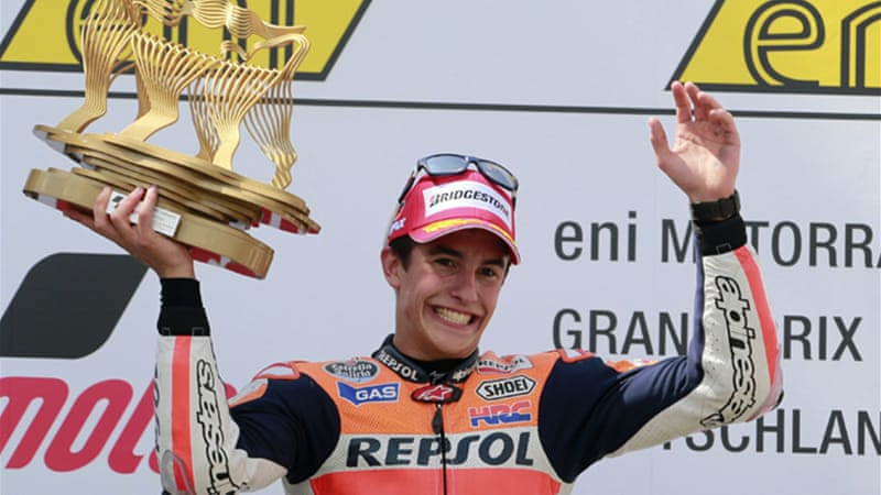 Marquez lifts the trophy after winning the German Grand Prix at the Sachsenring circuit in Germany  [Reuters]