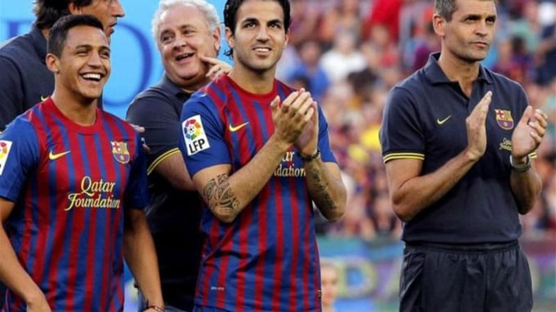Rumours have linked Barca's Fabregas (C) with a move back to the Premier League [EPA]
