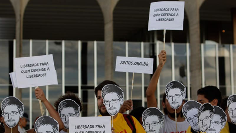 "Demonstrators in Brazil hold signs reading ""Freedom for those who defend freedom,"" at a protest on July 18 [AP]"