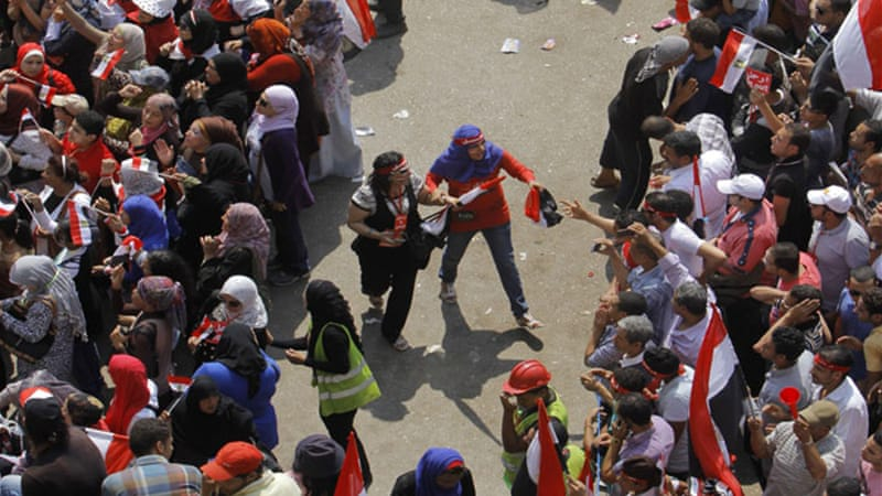 Volunteers formed a safe zone between men and women to prevent sexual harassment in Cairo, July 3 [AP]