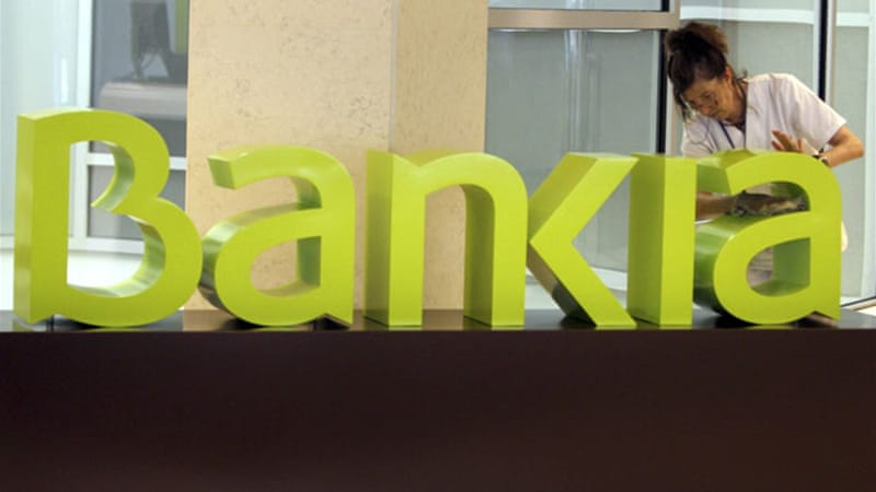 Bankia swung back into profits in the first half after running up a loss of $25bn for the full year of 2012 [EPA]
