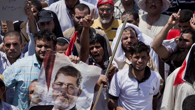 Morsi supporters say they will not back down [Reuters]