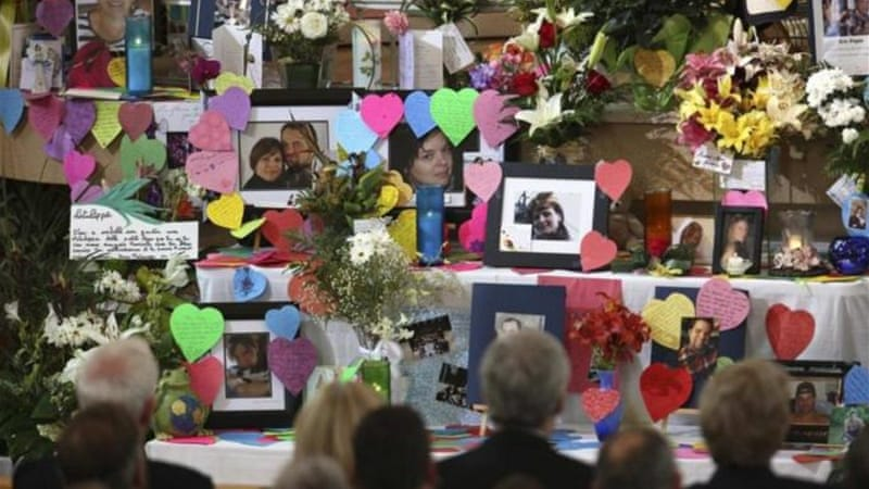 Pictures of missing victims are seen during a memorial ceremony at the Sainte-Agnes church [Reuters]