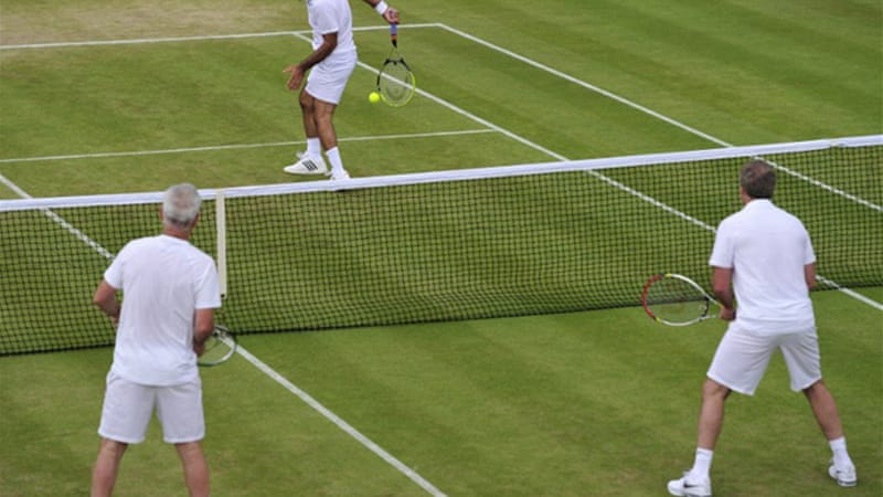 Bahrami pulls out his trick shots against John and Patrick McEnroe [AFP]