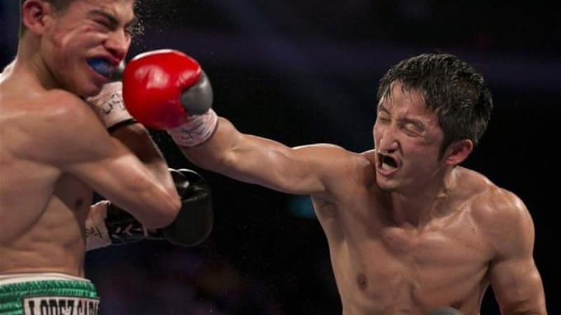 Zou Shiming's (R) defeat over Jesus Ortega helped raise popularity of boxing in China and Macau [AP]