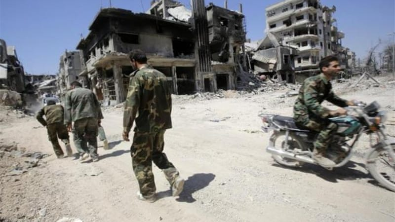 Government troops continued to make advances in the central city of Homs [AFP]
