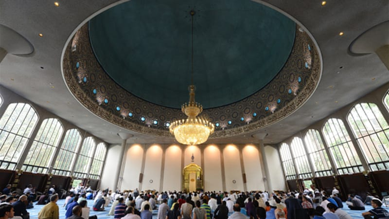 Muslims celebrate Eid al-Fitr, marking the end of Ramadan, at the Regent's Park Mosque in London in 2012. [AFP]