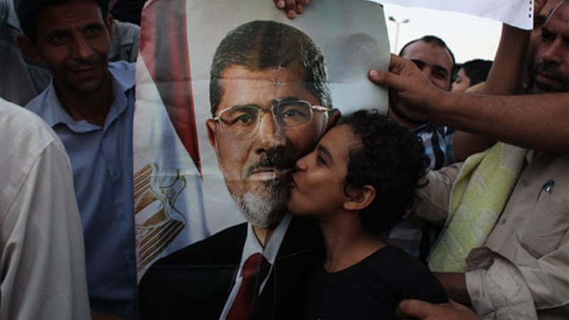 "People supporting Morsi rallied to support the ""legitimacy"" of his election in June last year [Al Jazeera/Matthew Cassel]"