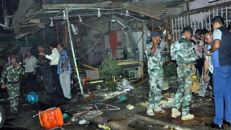 Car bombs ripped through Baghdad cafes while blasts struck elsewhere, killing 91 people on Saturday [AFP]
