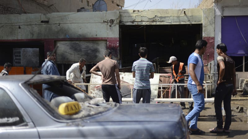 At least seven people were killed in two car bomb attacks, including several policemen [Reuters]
