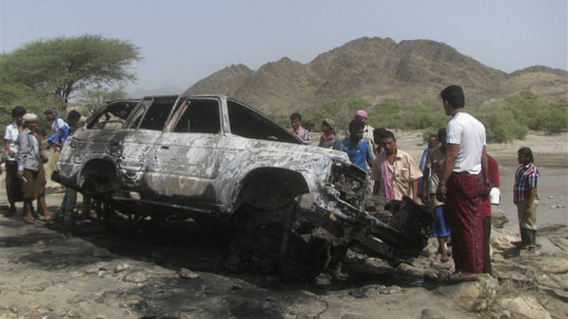 People gather at the site of a drone strike in the southern Yemeni province of Lahj, August 11 [Reuters]