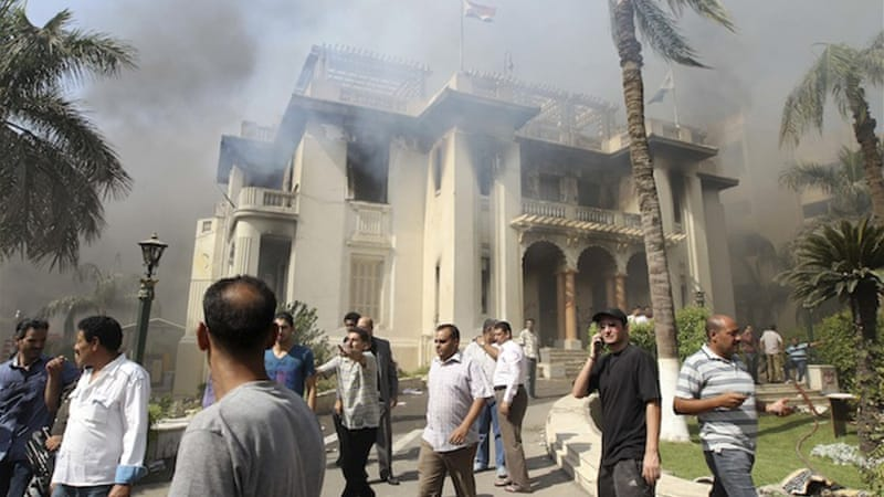 The announcement comes after protesters set fire to a local government office in Giza [Reuters]