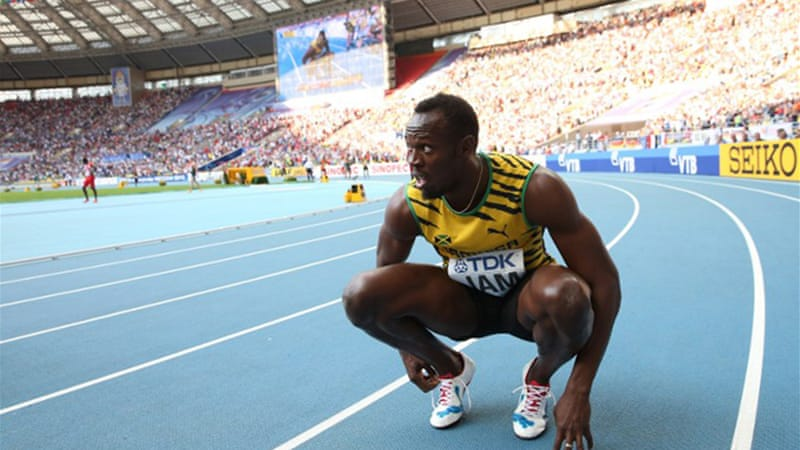 Bolt's victory in the 100m, 200m and 4x100m sealed his place in athletics history [AFP]