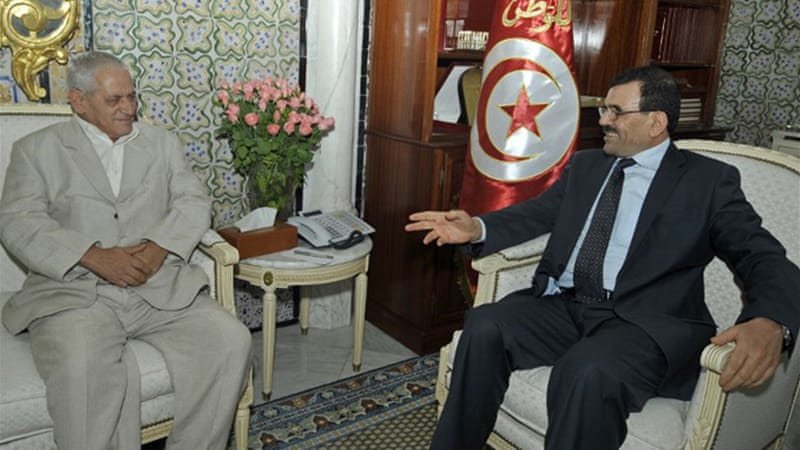 Houcine Abbassi, UGTT chief, seen here with Larayedh, is seen as close to the opposition [AFP]