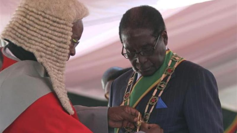 Mugabe, 89, was sworn in for a fresh five-year term in the southern African nation [Reuters]