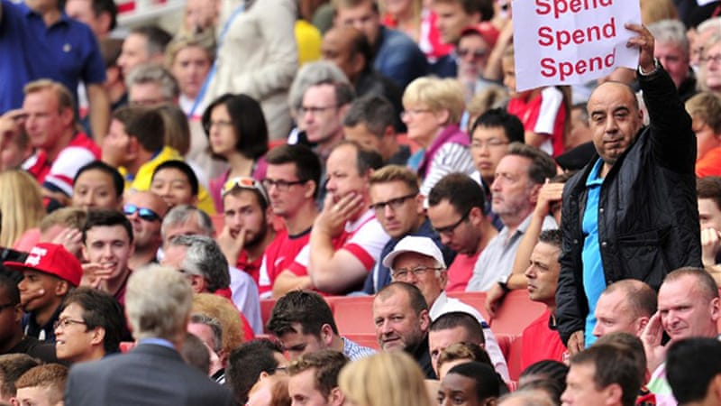 Fans are angry about Arsenal's eight-year trophy drought and are urging the manager to spend [AFP]