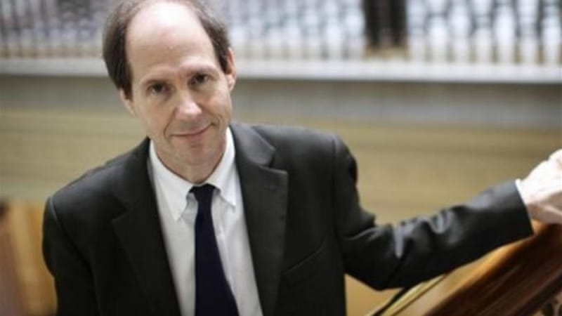 Cass Sunstein, a former Obama administration official, is one of five members of the review panel [AP]