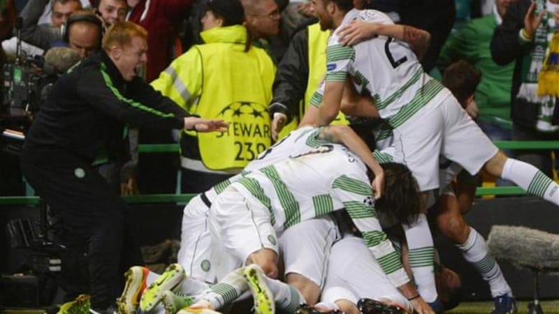Celtic manager Neil Lennon (L) dives into pile-up after James Forrest scores decider very late on [Reuters]