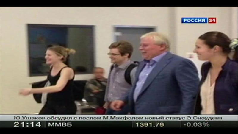 NSA whistle blower Edward Snowden and Sarah Harrison (L), a legal researcher for WikiLeaks, leave Moscow's Sheremetyevo airport after Snowden spent nearly six weeks in hiding there [Reuters]