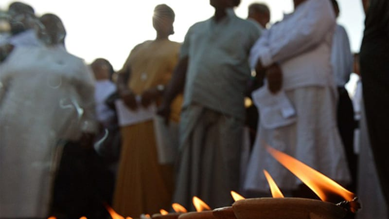 Christian priests and nuns joined a candle-light vigil in the capital to protest against the military action [AFP]