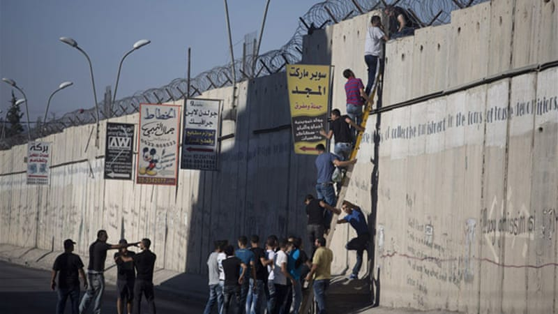 Some Palestinians denied entry to Israel during Ramadan decided simply to scale the wall [Oren Ziv/Active Stills]