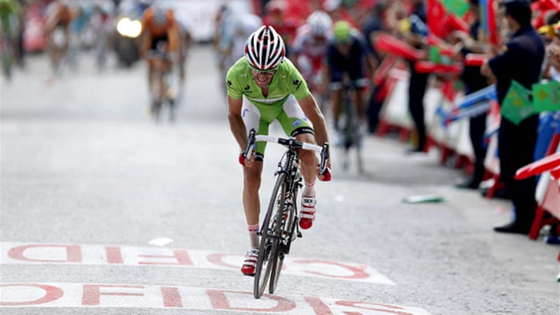 Moreno broke away near the finish line to snatch the leader's jersey from Nicolas Roche by one second [EPA]