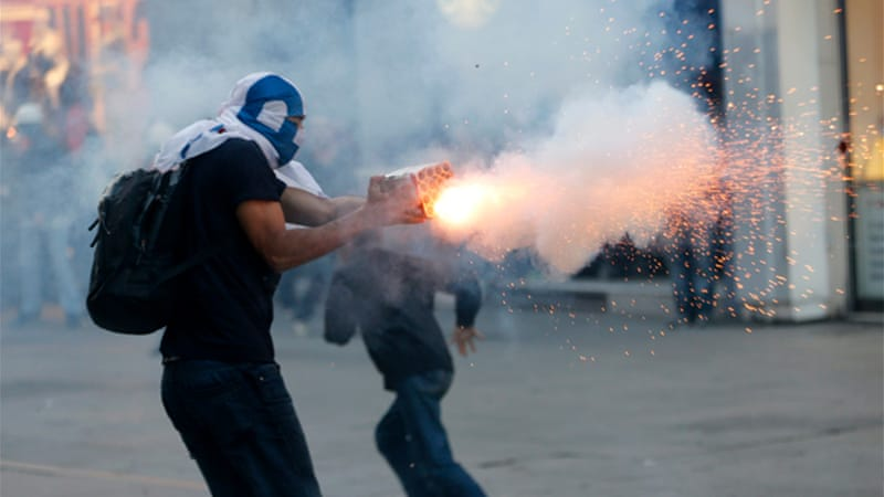 Police fired teargas canisters and plastic pellets into side streets in Istanbul as protesters fled [Reuters]