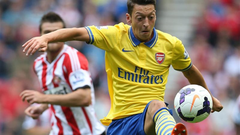 Mesut Ozil made a satisfying debut for Arsenal in their comfortable 3-1 win at Sunderland [AFP]