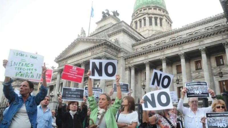 Protesters rally against an Iran-Argentina investigation of the 1994 bombing of a Buenos Aires Jewish centre [EPA]