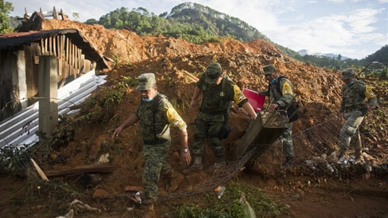 Many are feared dead from a mudslide in the southwestern village of La Pintada, near Acapulco [AFP]