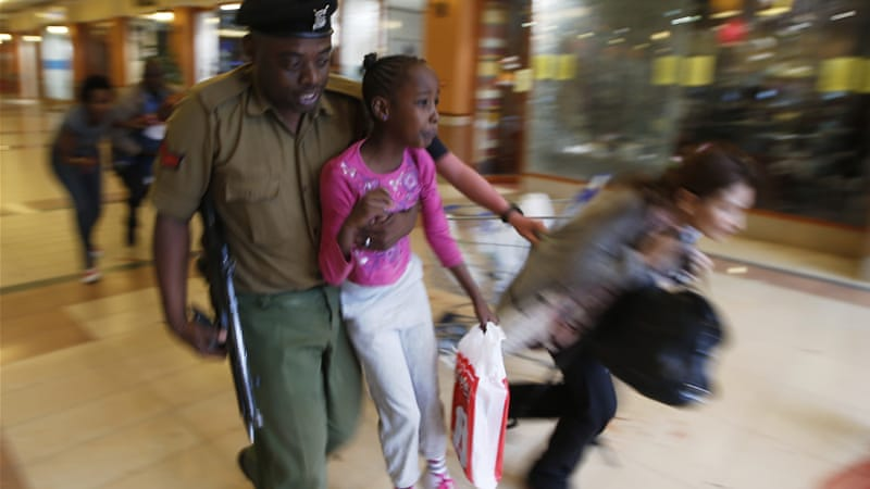 Soldiers carried children and led other victims to safety as armed police combed the shopping centre [Reuters]