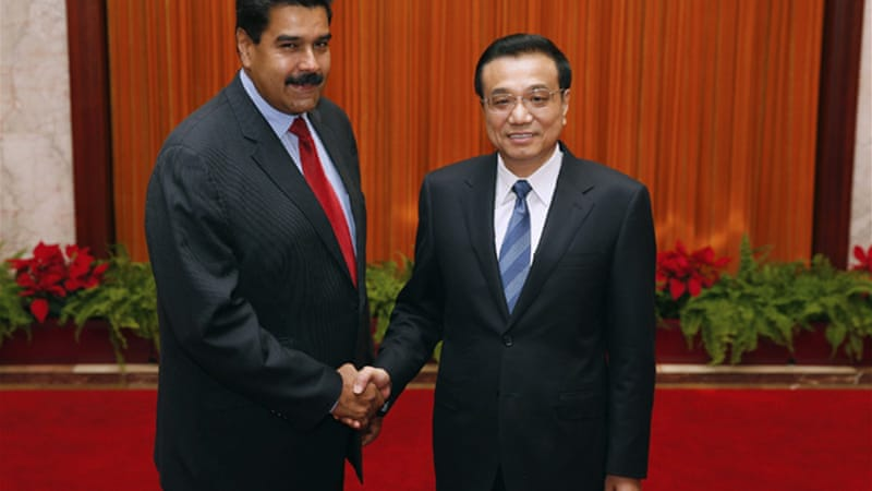 Nicolas Maduro, left, said he received threats during layover in Vancouver after visiting China [Reuters]
