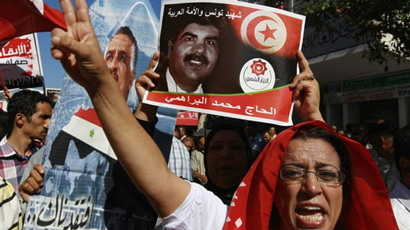 Tunisia has become increasingly polarised with anti- and pro-government protests after murder of Brahmi  [Reuters]