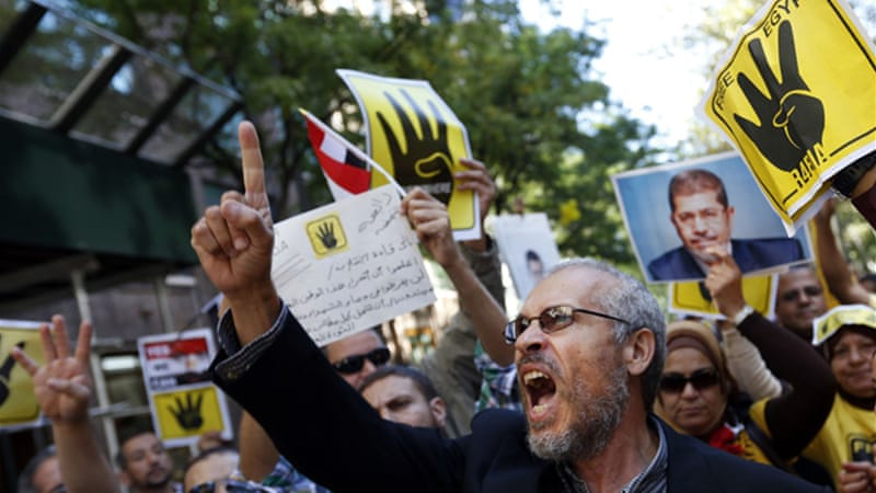 Many Morsi supporters staged a rally outside the UN headquarters during Fahmy's speech [AP]