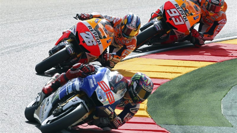 Marquez's Honda team mate Pedrosa, pictured centre, crashed out with 18 laps to go [EPA]