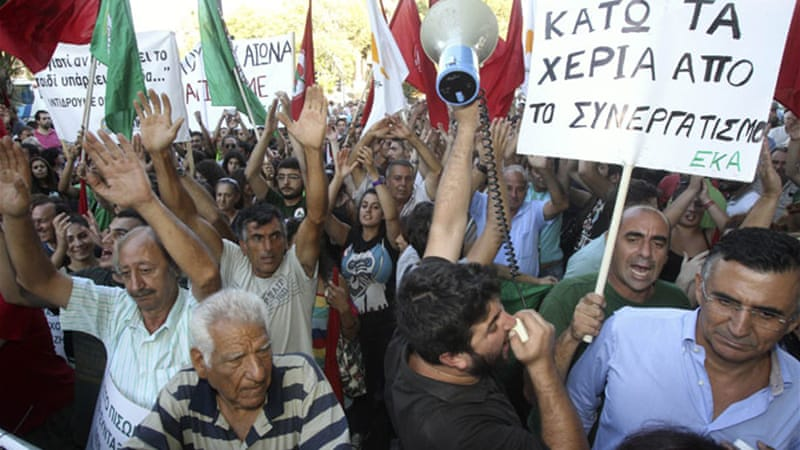 Cypriots protest against austerity measures in a demonstration outside the parliament in Nicosia [Reuters]